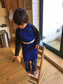 Ned in a Le Creuset Junior Apron