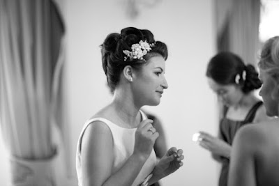 High wedding hair in Inverness from the side with flower detail
