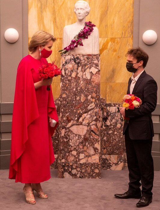 Queen Mathilde wore a red fuchsia silk gown from spring summer 2020 collection of Natan. Queen Elisabeth Piano Competition 2021