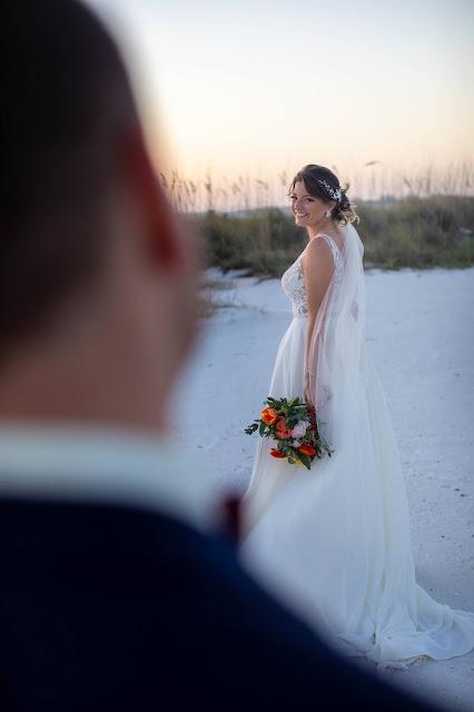 Groom and bride destination wedding first look.
