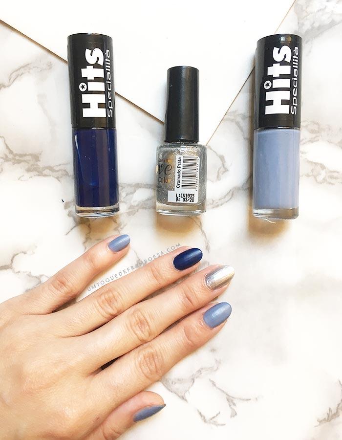 Unhas decoradas simples na tendência das unhas multicoloridas e os esmaltes azul, prata e cinza utilizados