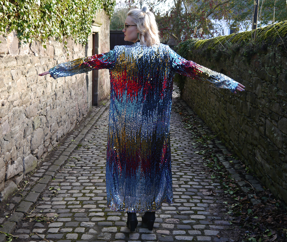 Street style with full length sequin rainbow jacket by UK designer isolated heroes