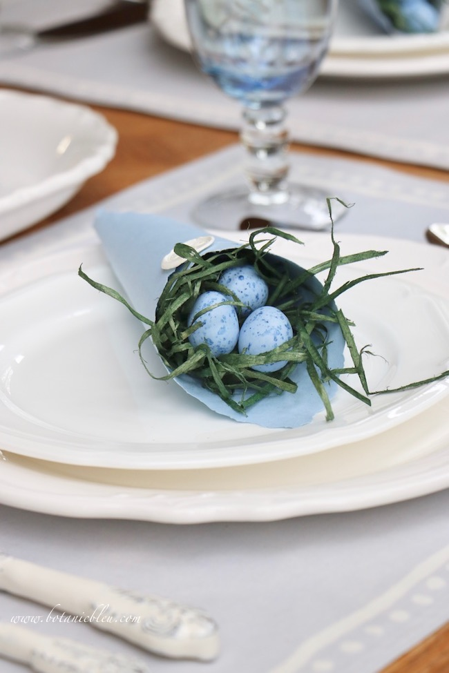 Easter Table With Bluebonnets has handmade blue paper cones filled with blue candy eggs