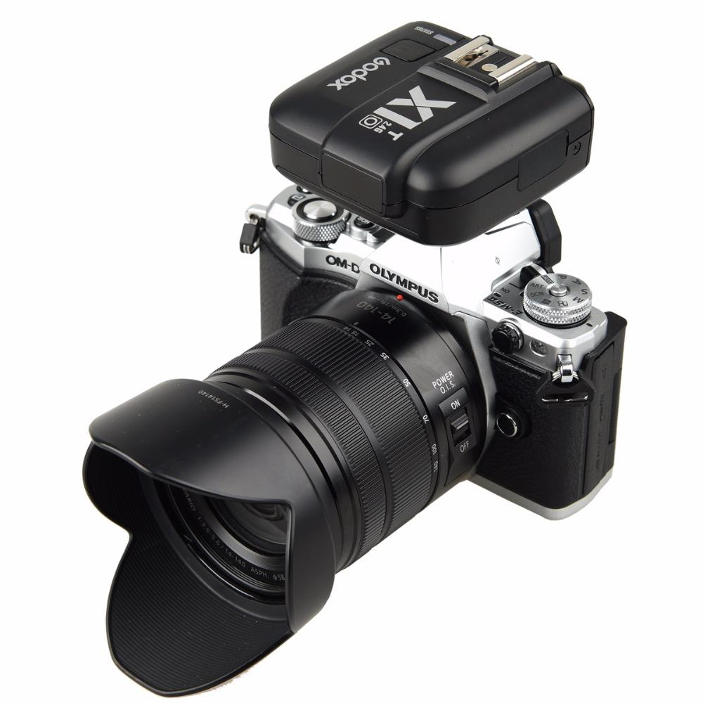 Синхронизатор Godox X1T-O на камере Olympus