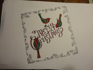 Christmas image with red and green birds, stamped holly border
