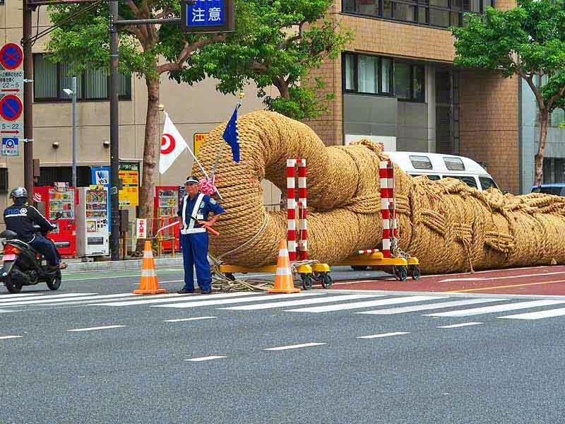 Japanese policeman,half of tug-o-war rope,street