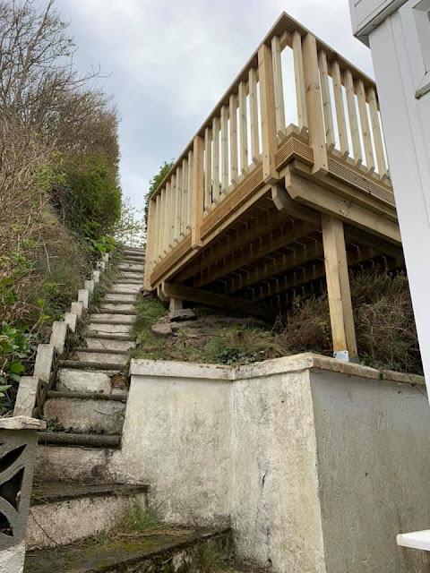 sloping garden deck