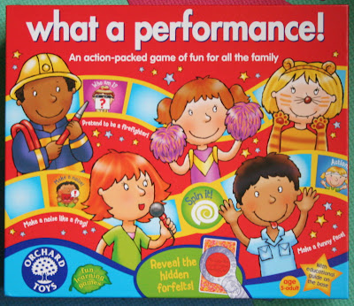 What A performance game by Orchard Toys Box front