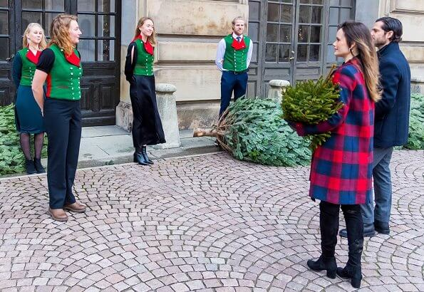 Princess Sofia wore a new plaid wool coat from Tommy Hilfiger, and a black arcelia dress from Dagmar, and leather boots from Zara. Gold earrings