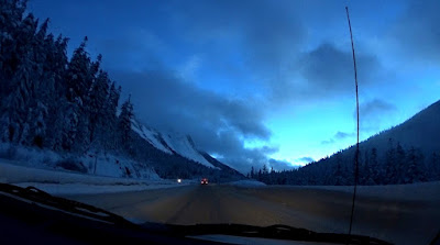 Snowy conditions before sunrise at the Coquihalla Pass