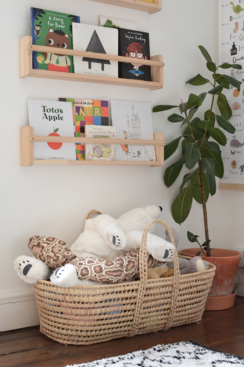 modern nursery with book shelves