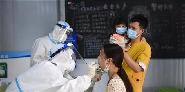 Medical staff take samples to test for COVID-19 for people in Nanjing city, Jiangsu province, China on July 29, 2021.