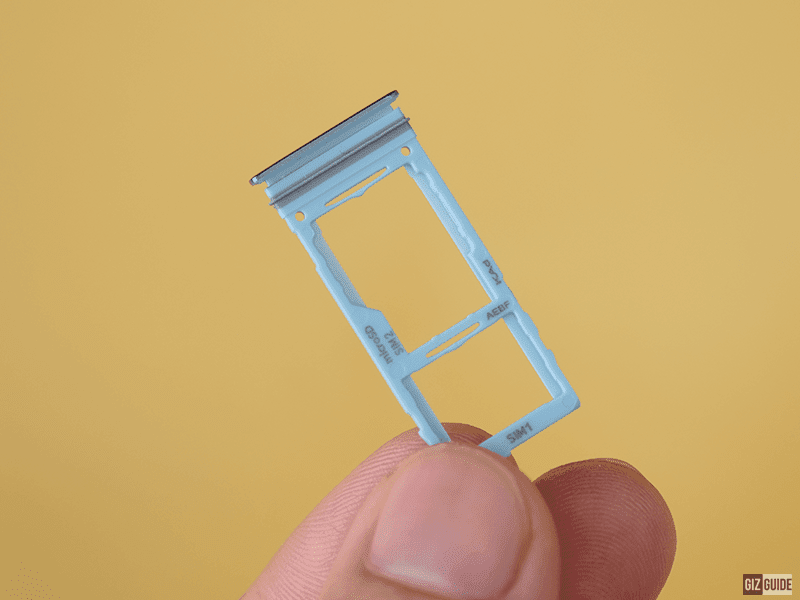 The rubber gasket on the SIM tray