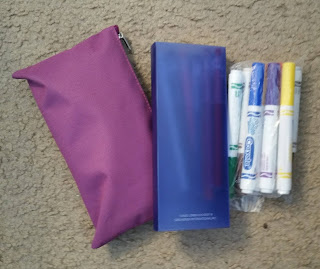 Pencil bag, pencil case, and water based markers in a baggie