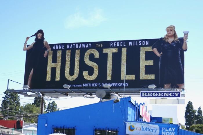 Hustle glittering logo billboard