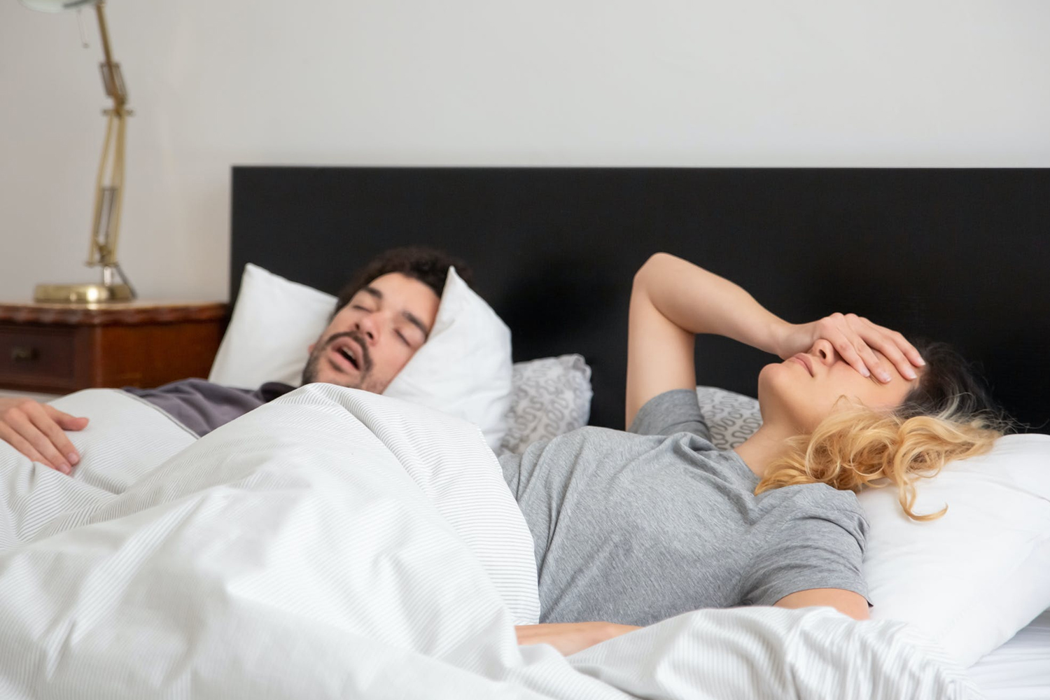 couple are laying in the bed
