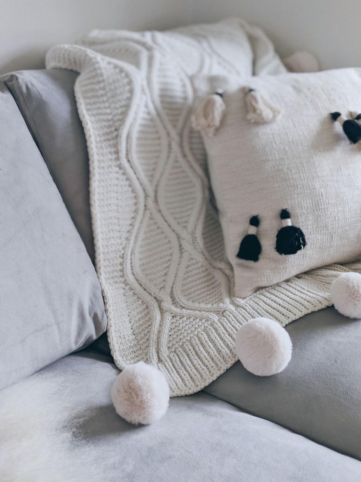 white pom pom blanket