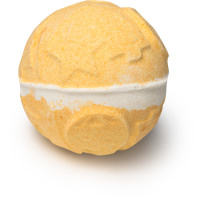 A gold white and orange bath bomb on a bright background