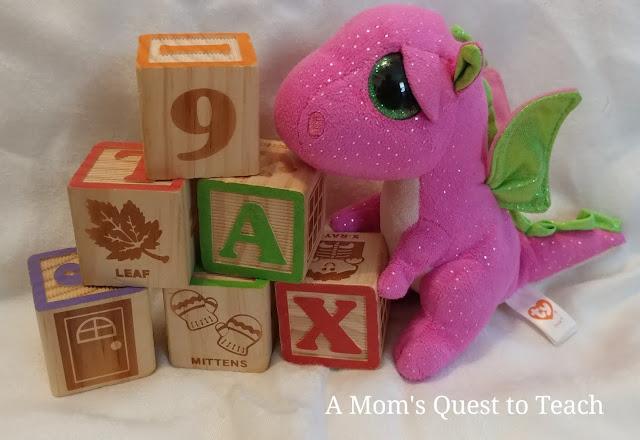 blocks and plush dragon