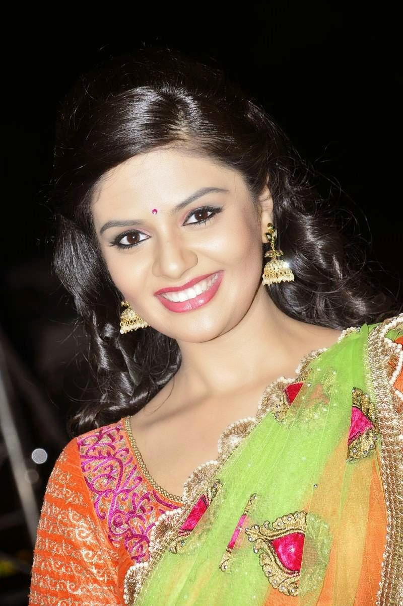 Sreemukhi Stills In Orange Half Saree