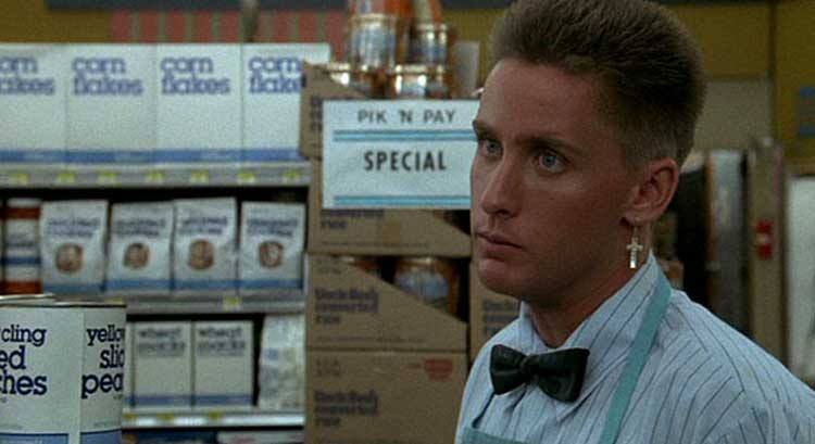 Emilio Estevez works in a soul-killing job in Repo Man.