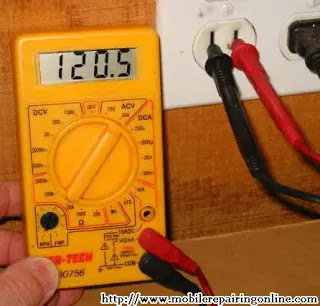 use a multimeter to test voltage of live wires measure voltage at home