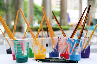 Picture of plastic paint pots with brushes