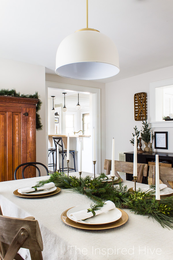 Fresh greenery holiday tablescape in a modern traditional dining room