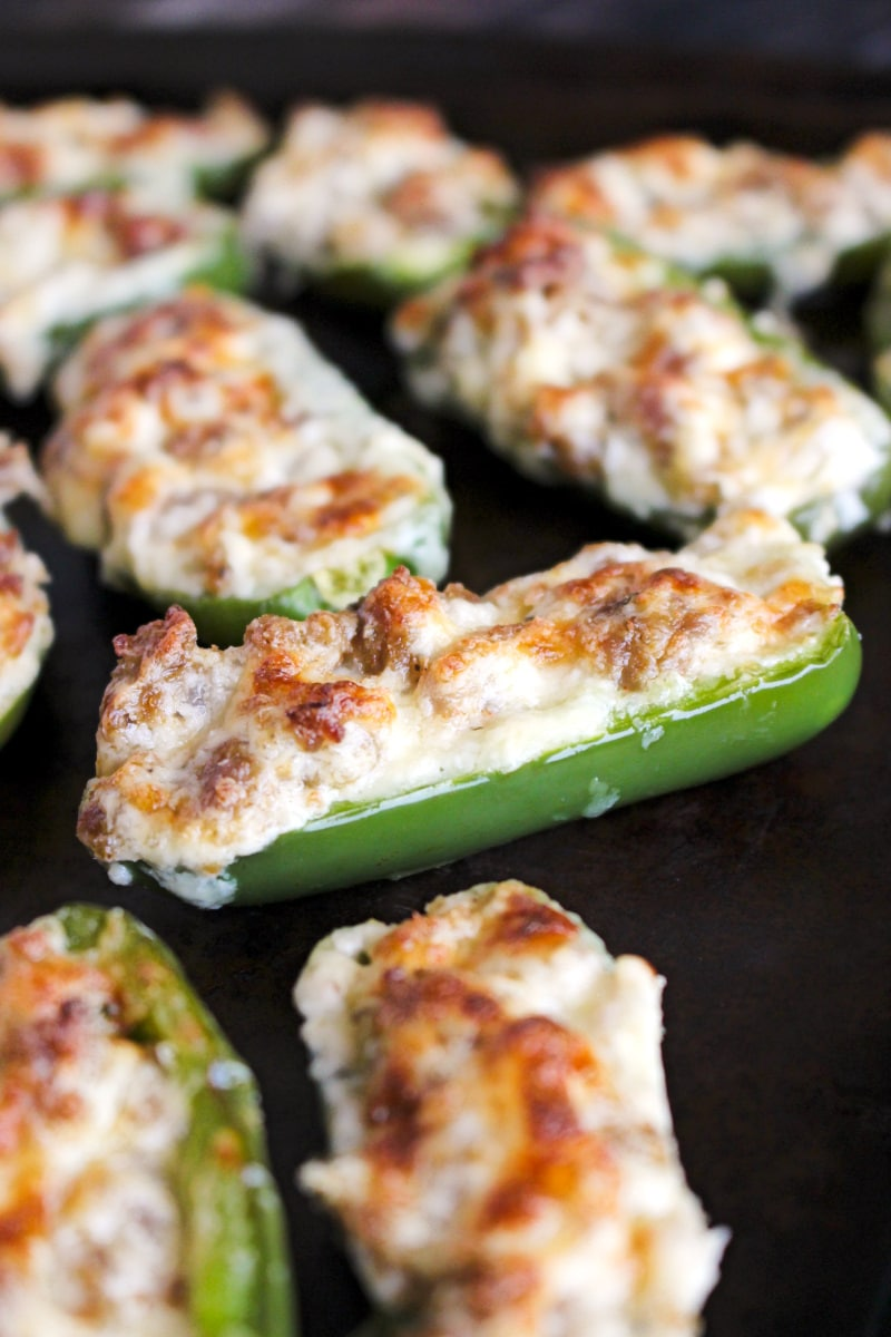 Side view of Sausage Jalapeño Poppers on a sheet pan.