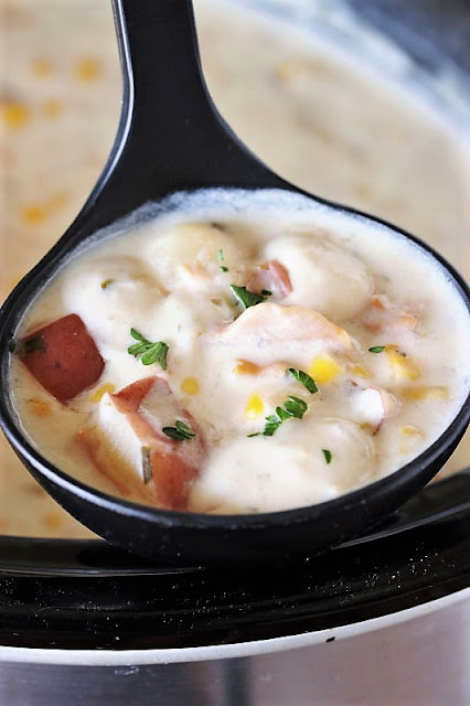 Ladle of Slow Cooker Clam Chowder Image