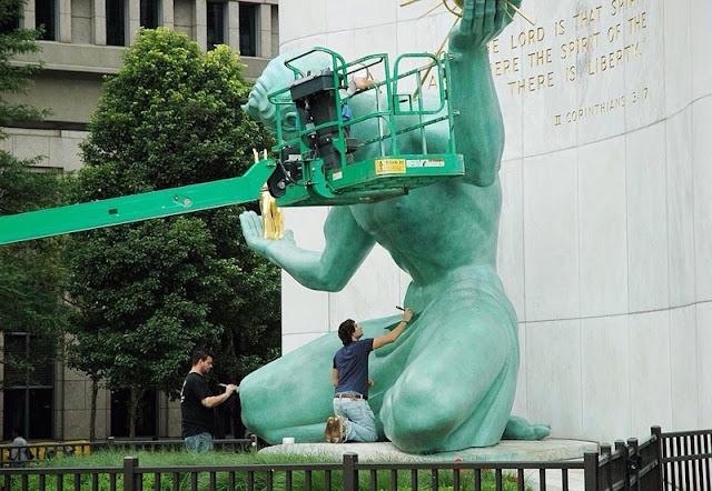 Restoring a big statue, green lift
