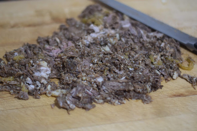 The leftover Mississippi Pot Roast finely chopped on a cutting board.