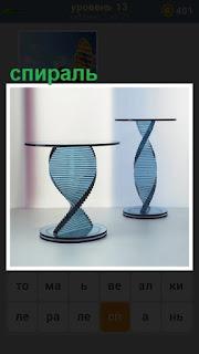 в помещении стоят два стола собранные из спирали