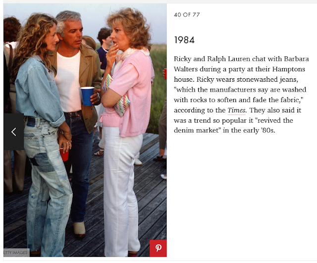 A screengrab showing a photo of a man and woman (Ralph Lauren and his wife Ricky) standing outside chatting with a woman (Barbara Walters). The Laurens are wearig blue jeans and casual jean jackets. Walters is wearing whie pants and a pink top. This picture is from 1984 and the hair corresponds.