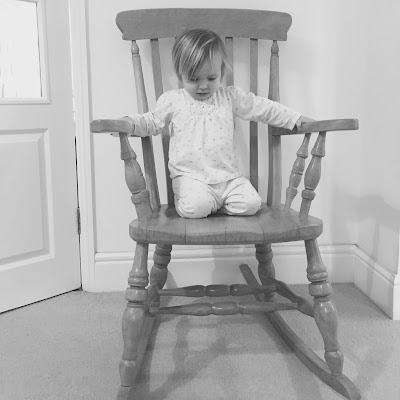 Lottie age 2 sitting in the rocking chair