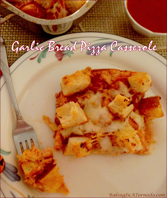 Garlic Bread Pizza Casserole, garlic bread meets pizza meets lasagna in this family friendly dinner. Recipe developed by www.BakingInATornado.com | #recipe #dinner
