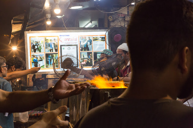 People ordering kebabs kabab at Qureshi Kabab Corner across Jama Masjid in Old Delhi India