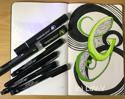 ink drawing of a G on a moleskin sketchbook with drawing pens and markers, artist Linzé Brandon