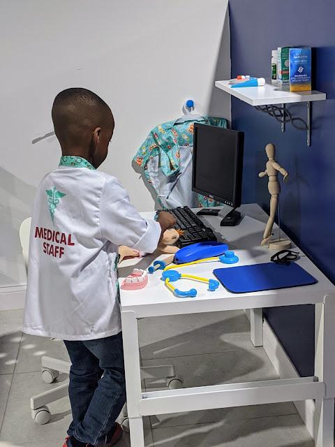 preschooler pretending to be a doctor