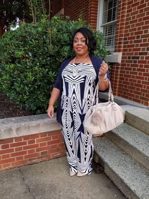 Curvy blogger in navy and blue jumpsuit, navy cardigan, nude pumps and handbag