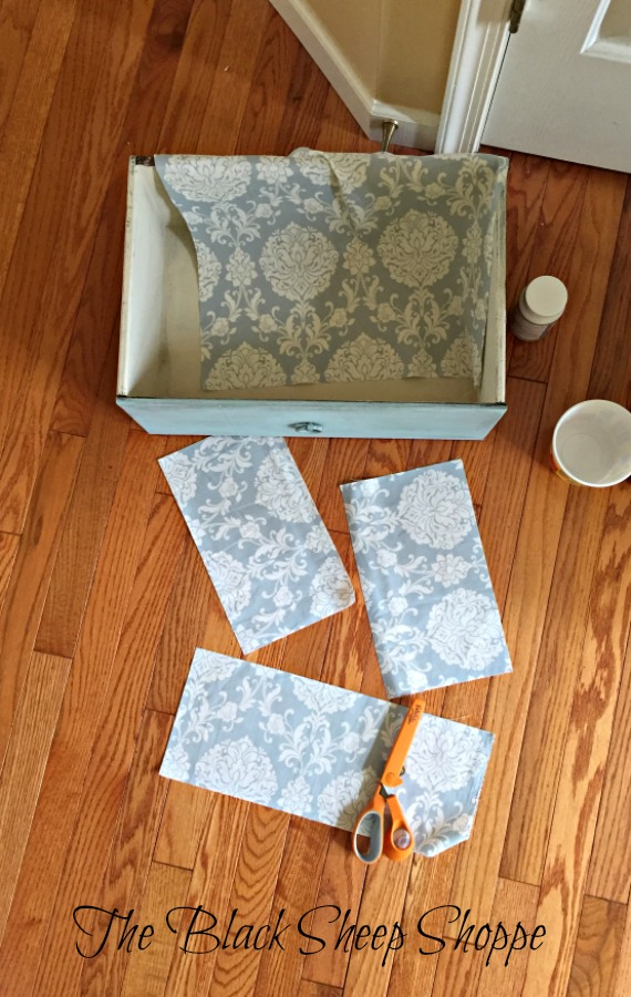 Pretty fabric is a perfect solution for covering up an ugly drawer interior.
