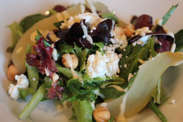 Salad with poached pears, hazelnuts, goat cheese, and white balsamic vinaigrette
