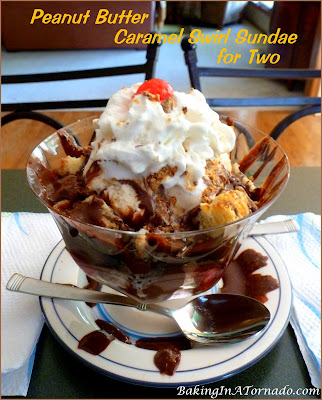 Peanut Butter Caramel Swirl Sundae for Two, a decadent dessert for sharing. Peanut Butter Cookie Blondies layered with Caramel Swirl Ice Cream, Butterfingers and Homemade Hot Fudge. | Recipe developed by www.BakingInATornado.com | #recipe #dessert