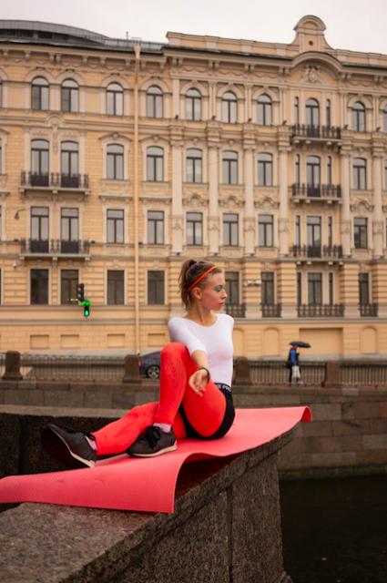 Woman Exercising In Public