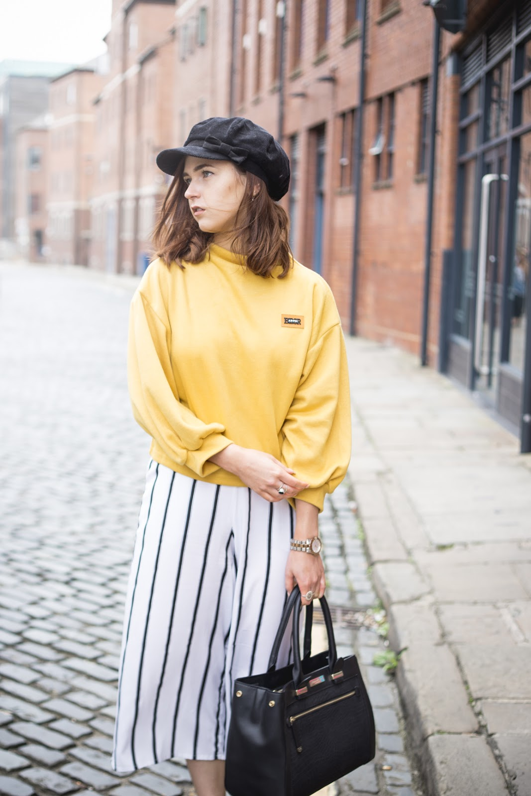 yellow jumper, stripe trousers