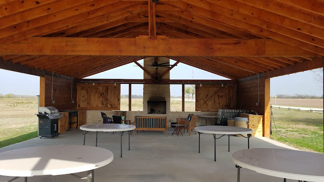 Tables, chairs and fireplace for group gatherings