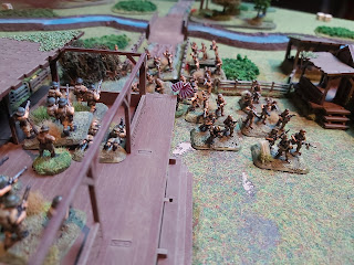 Japanese infantry pile into the village