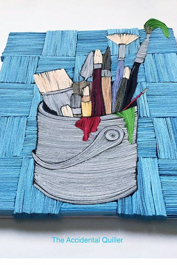 colorful paintbrush container wall art composed of layered paper strips