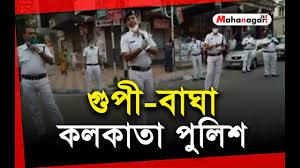 তোরা বাইরে ঘুরে করবি কী তা বল Lyrics - Kolkata Police Song - #GoCorona - Lyrics Over A2z