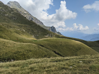 Returning from Rifugio Grassi back down trail 104 with surreal landscapes and Pizzo Tre Signore in view.